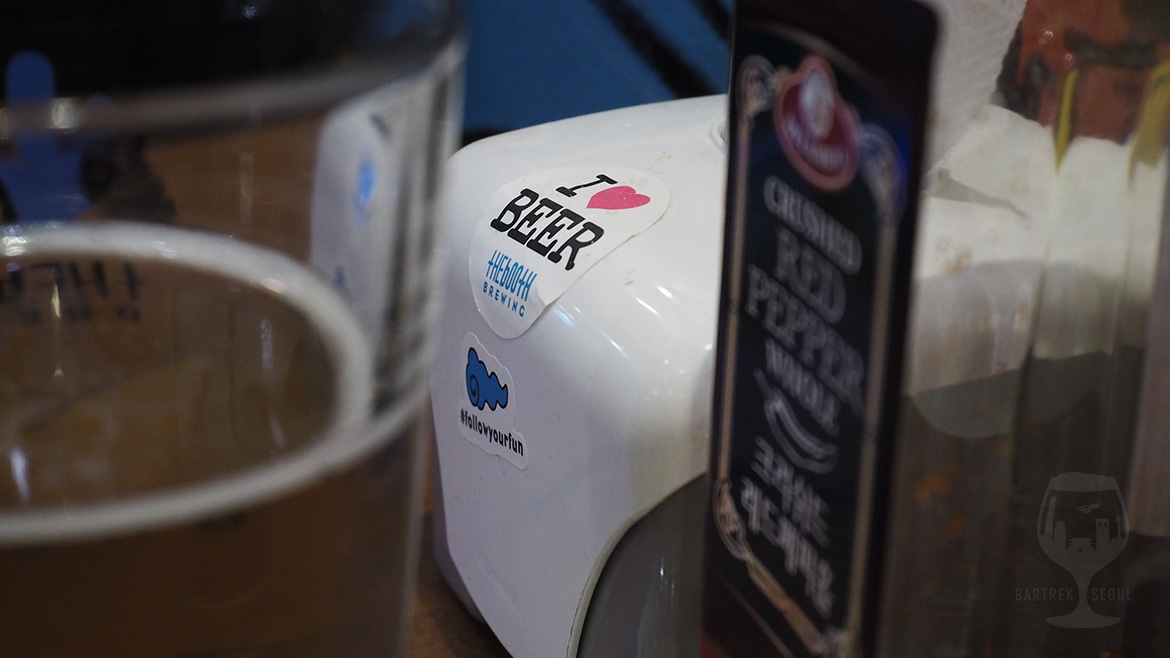 I love beer sticker on napkin dispenser.