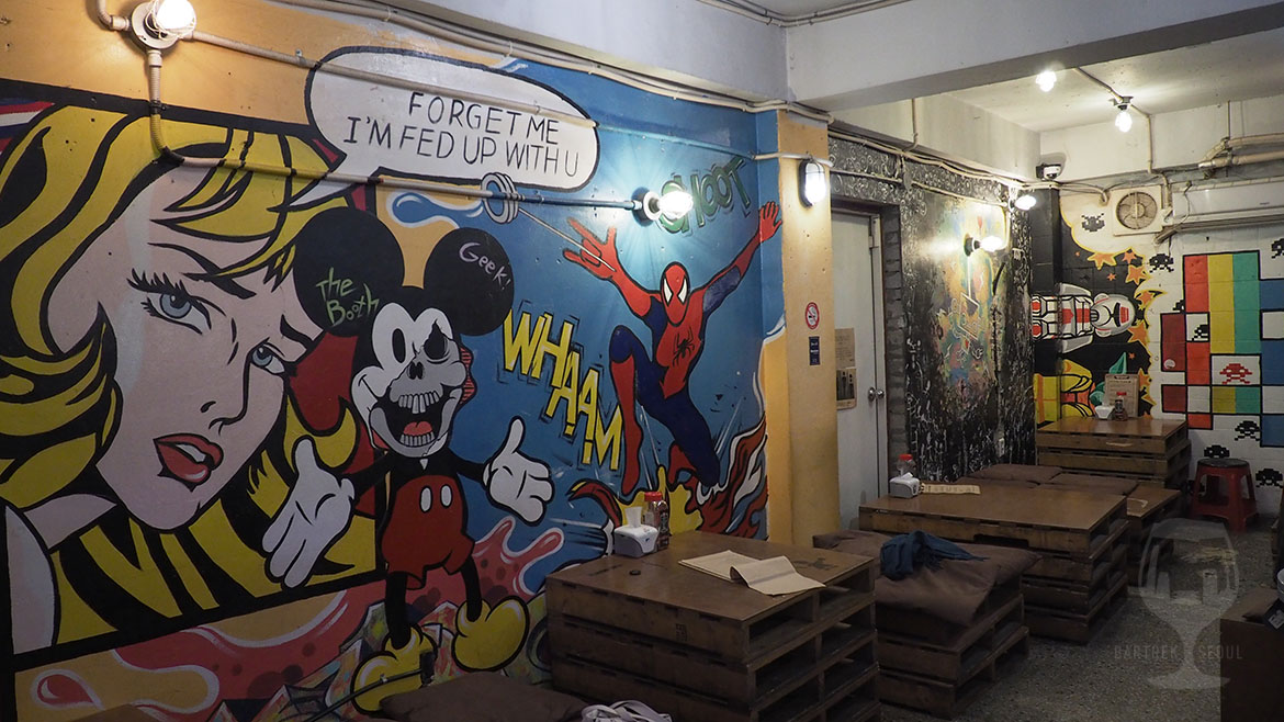 The booth itaewon pub walls are covered with paintings such as mickey mouse, spiderman and space invaders.