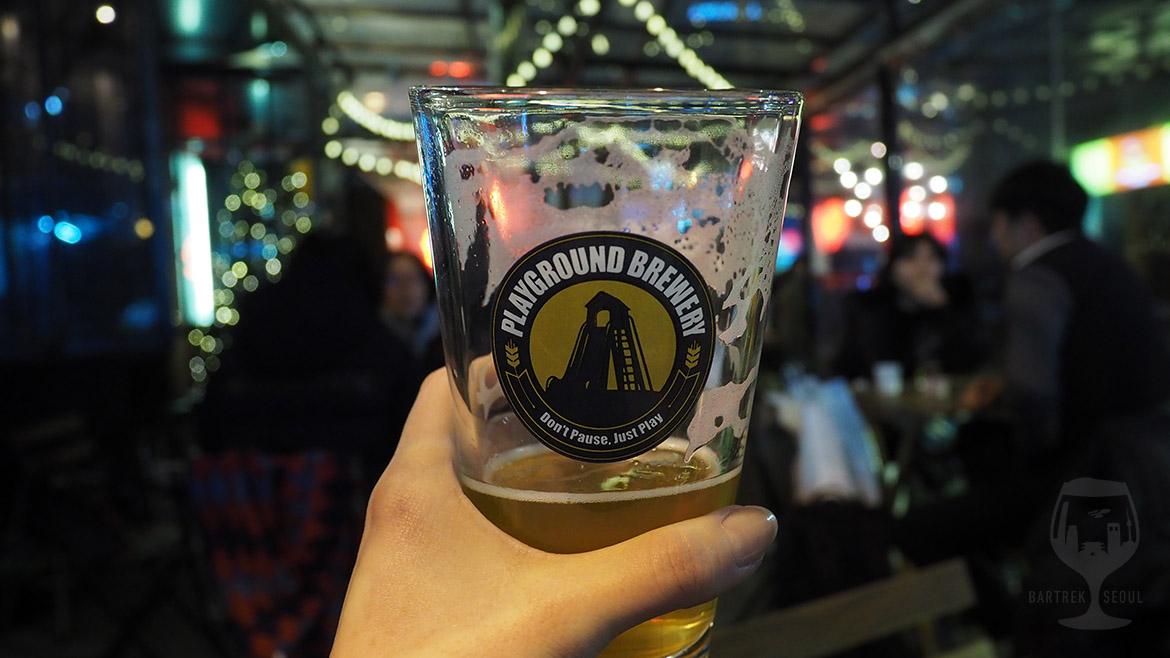 A glass of korean craft beer.
