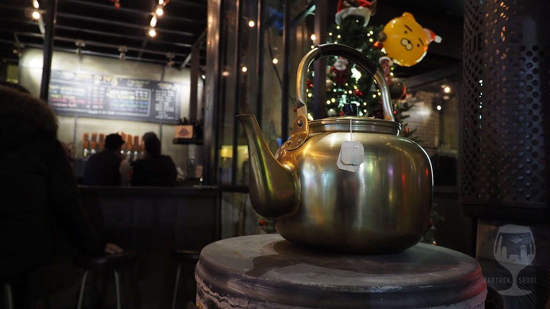 A metal tea pot on the stove.