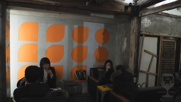 Gray orange wall painting.