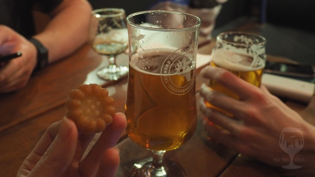 Three beer glasses and a traditional cookie.