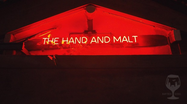 The Hand and malt red neon sign.