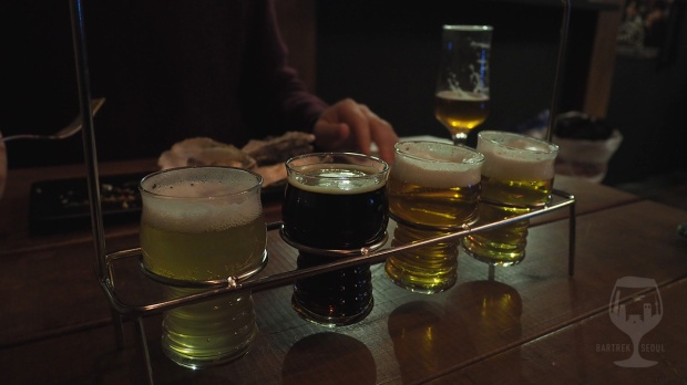 Four small taster glasses in a stand.