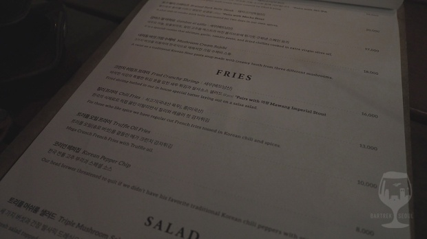 Picture of the food, side dish menu. They have for example fries and salads.