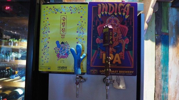 Indica IPA and the booth Red ale tap handles.