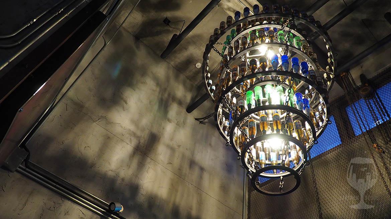 A huge chandelier made of beer bottles in a korean industrial style craft beer pub in Gangnam.
