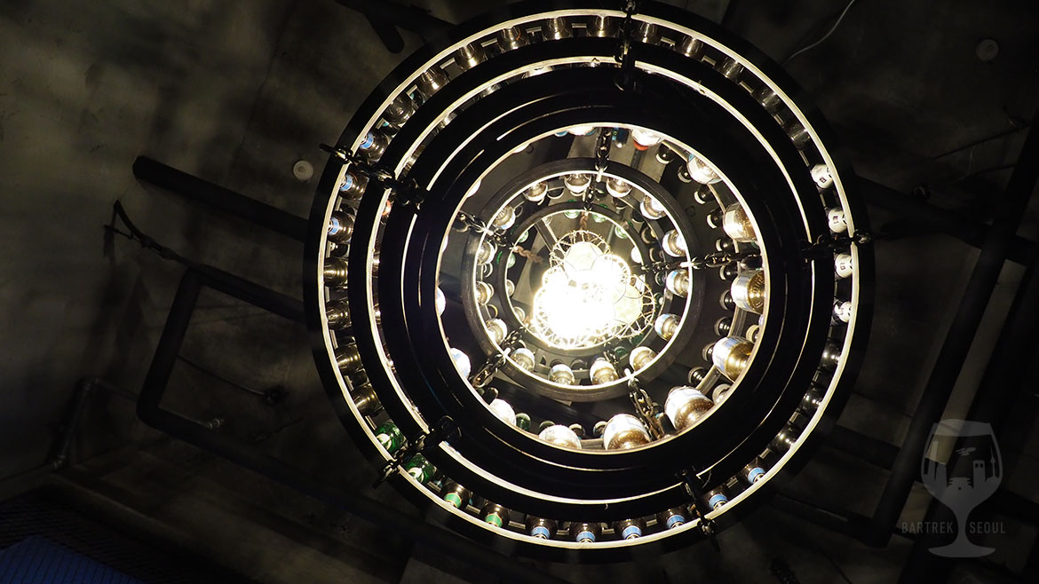 A huge chandelier made of beer bottles. A sight from below.