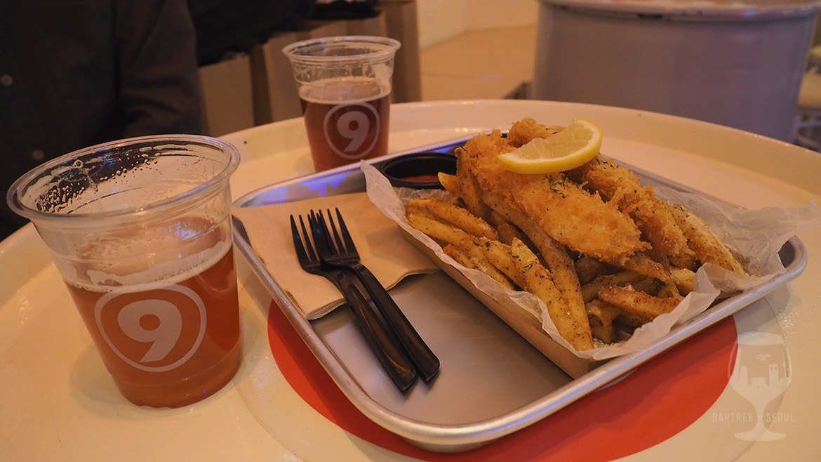 Fish and chips served on an outdoor festival style dish.