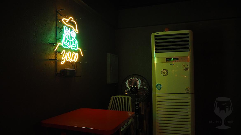 YOLO cactus neon sign.