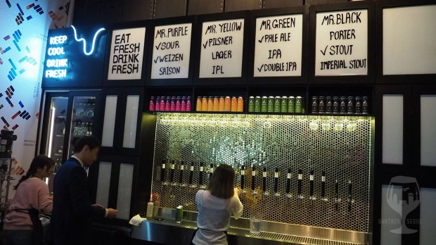 Taps and beer menu on the wall.